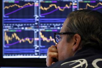 美股大多頭警告,美企的財報將紛紛下修財測前景,將對於美股狀況造成負面影響。(圖/美聯社)